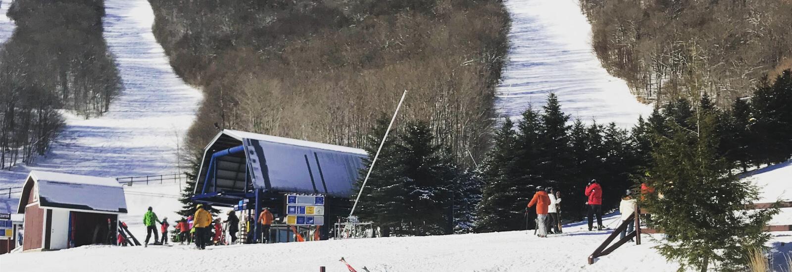 ski lift on a snowy mountaintop midwinter