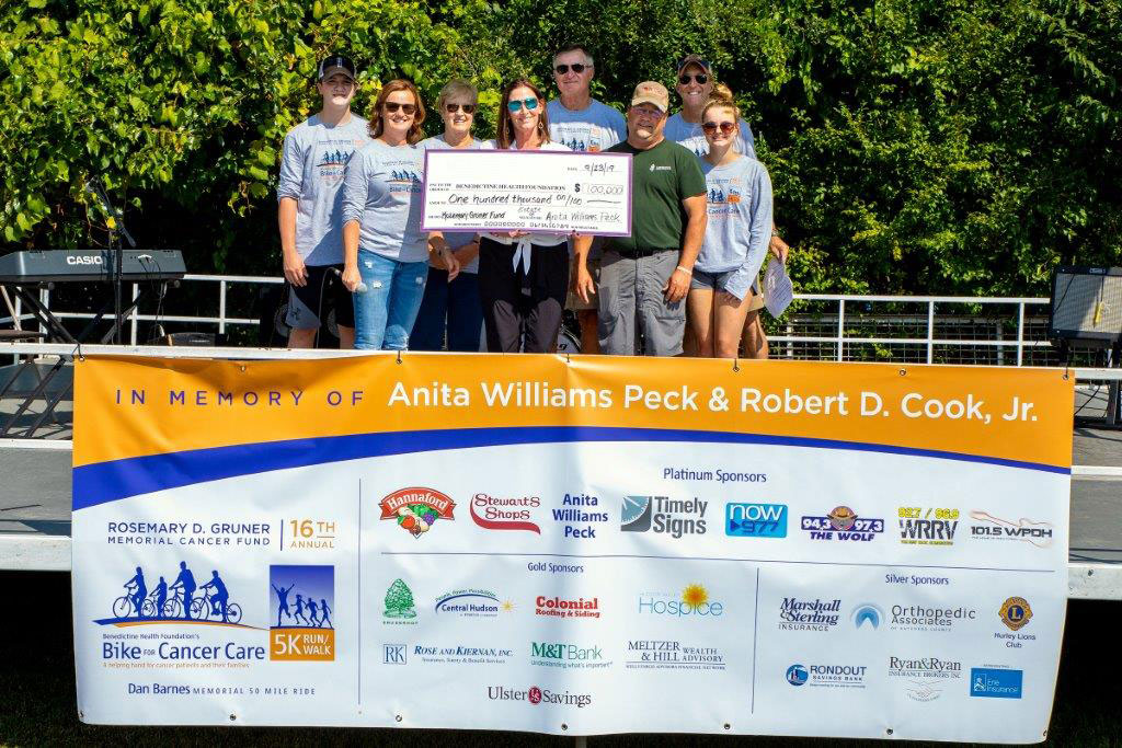 group of people holding giant check